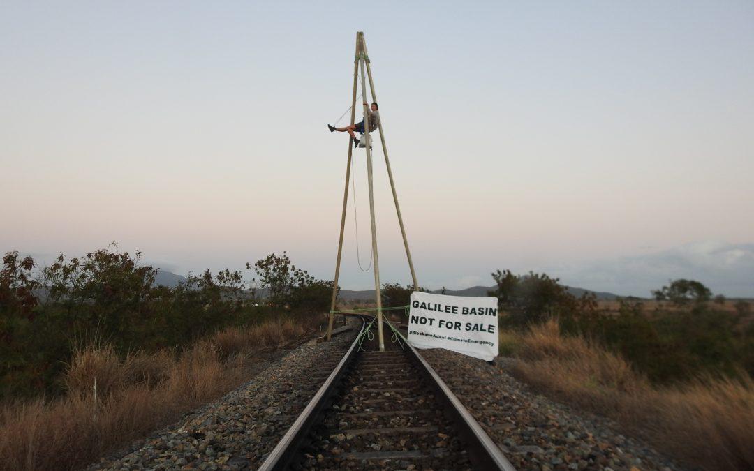 18 year old environmental activist locks on to Aurizon rail
