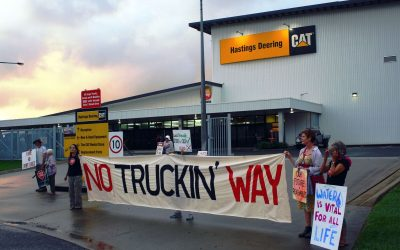 Over 40 Queenslanders disrupt work on Adani's megatrucks being assembled in Mackay